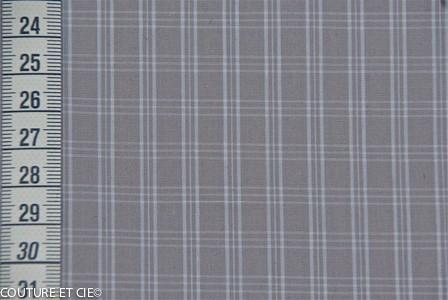 Carreaux blancs sur fond gris